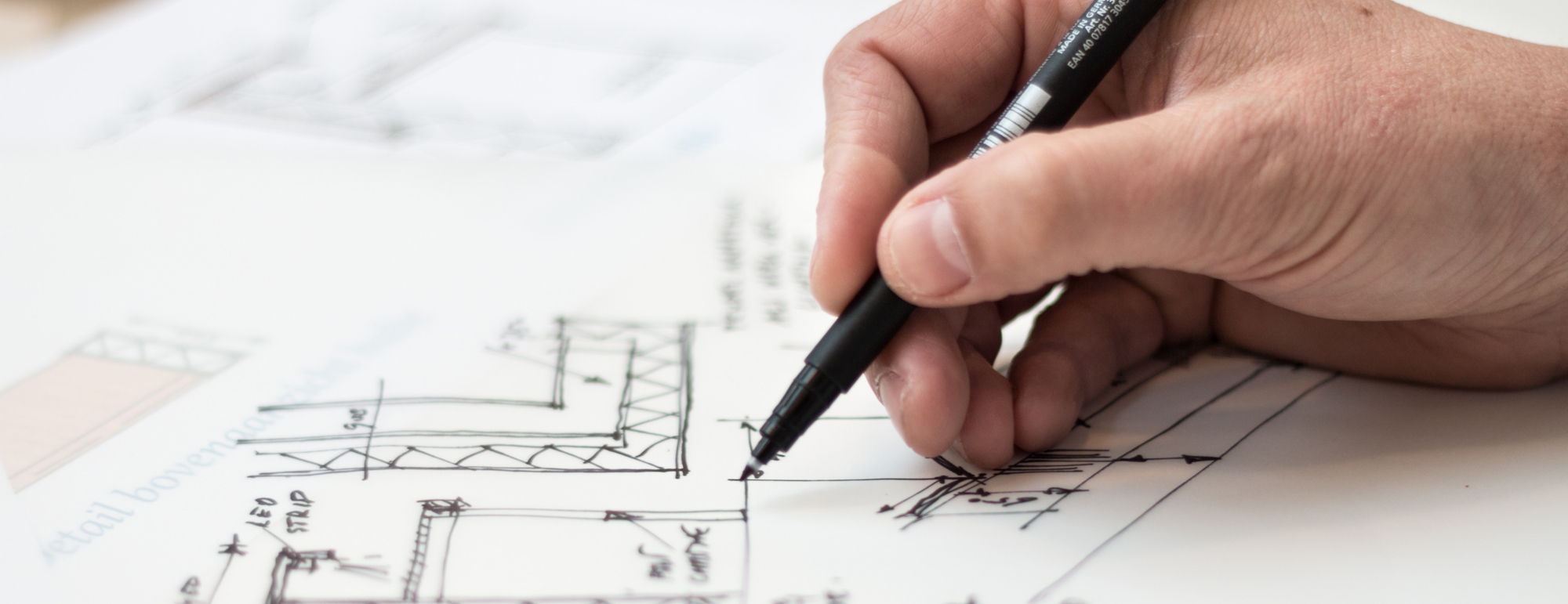 someone working on a building blueprint