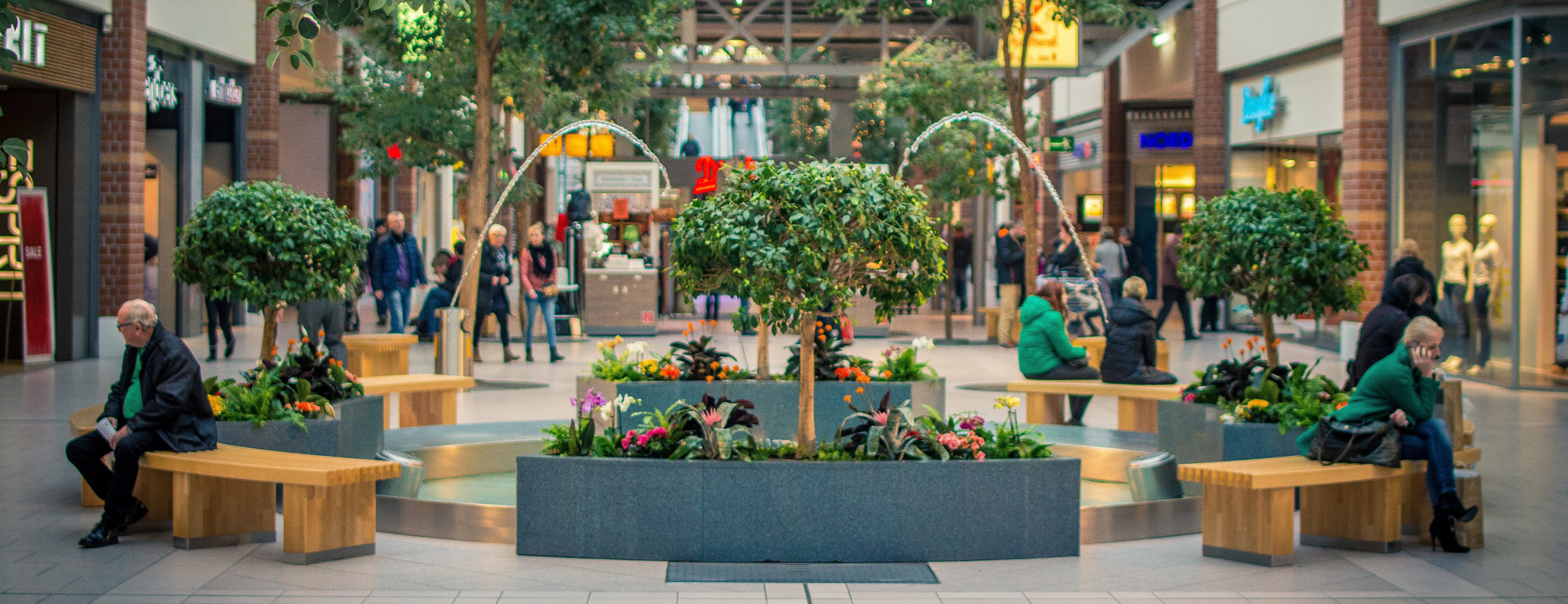 shopping center with benches and trees
